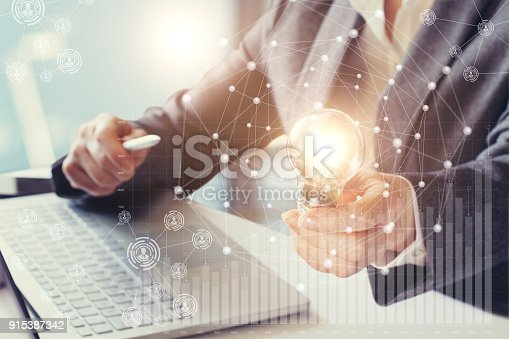 istock Businesswoman holding in his hand a burning lamp. 915387342