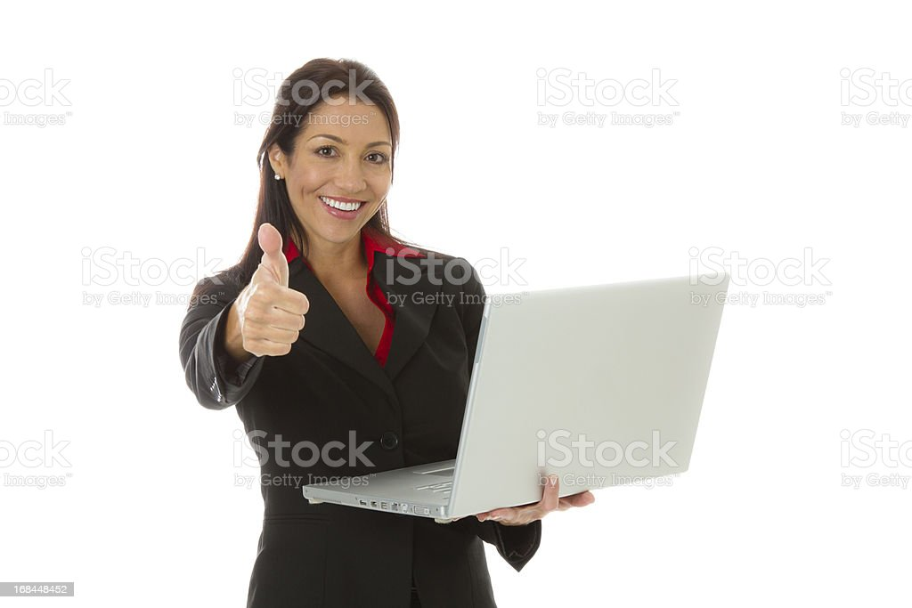 Businesswoman holding laptop and gestueing thumbs up royalty-free stock photo