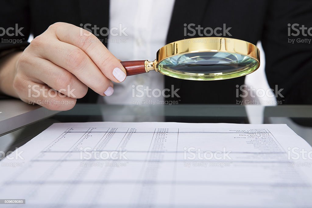Businesswoman Holding Magnifying Glass stock photo