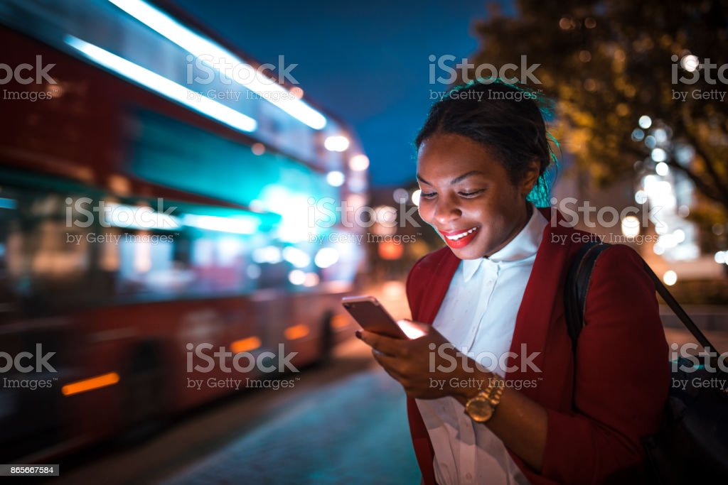 Businesswoman holding mobile phone stock photo