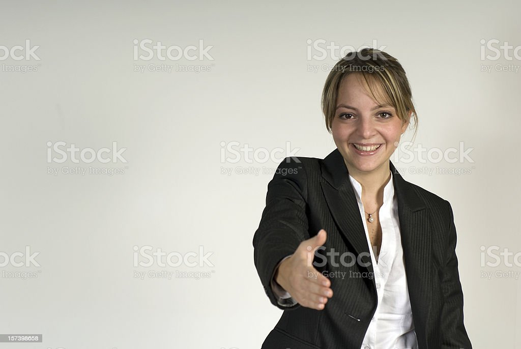 Businesswoman holding out hand for handshake, Istanbul, Turkey royalty-free stock photo