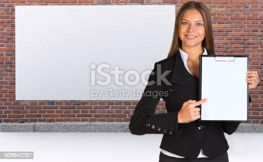 istock Businesswoman holding paper holder 509642251