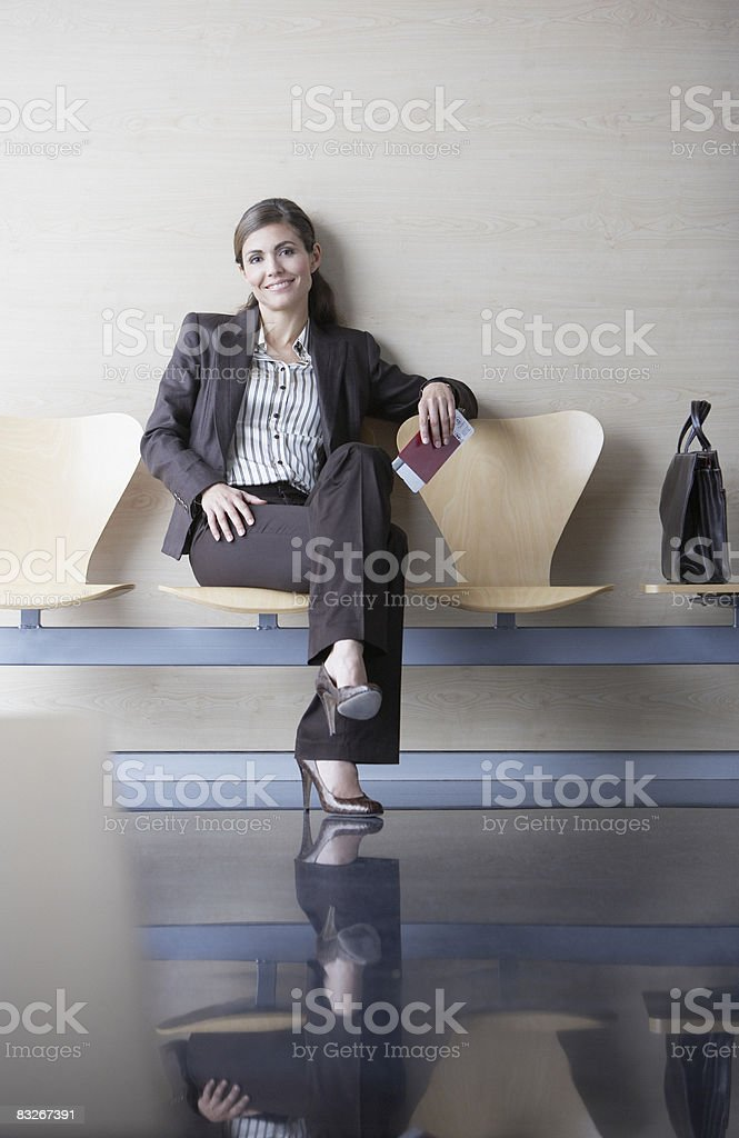 Businesswoman holding passport and airline ticket royalty free stockfoto