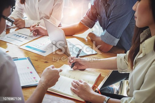 1032388356 istock photo Businesswoman holding pens and holding graph paper are meeting to plan sales to meet targets set in next year. audit budget and financial concept 1076967126