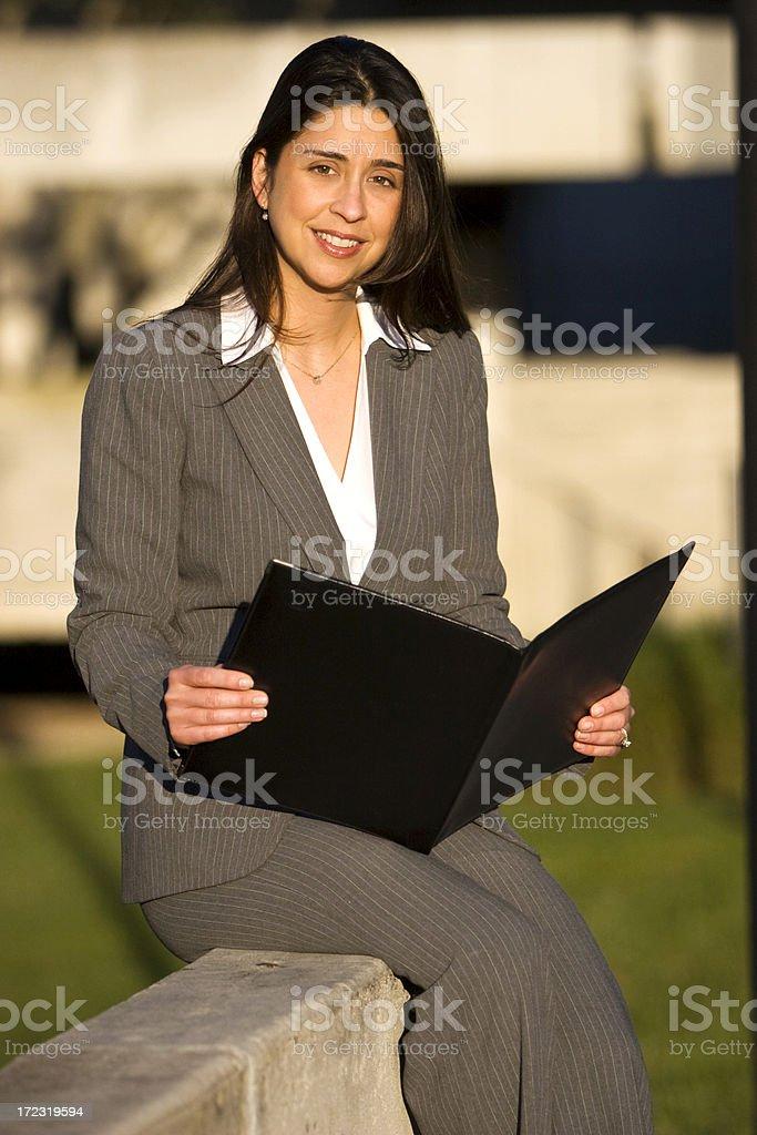 Businesswoman Holding Portfolio stock photo