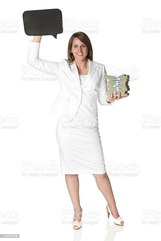 Businesswoman holding stacks of cash money stock photo