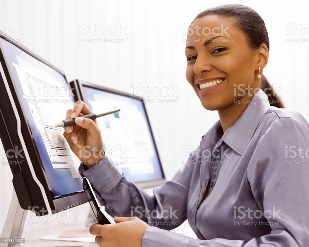 Businesswoman Holding Stylus to Computer Monitor royalty-free stock photo