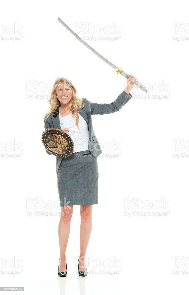 Businesswoman holding sword stock photo