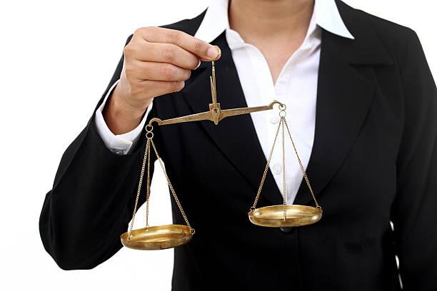 Businesswoman holding the justice scale stok fotoğrafı