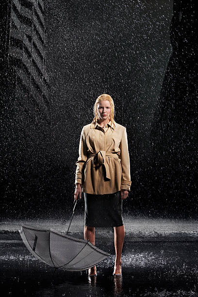 businesswoman holding umbrella upside down in rain - drenched stock pictures, royalty-free photos & images