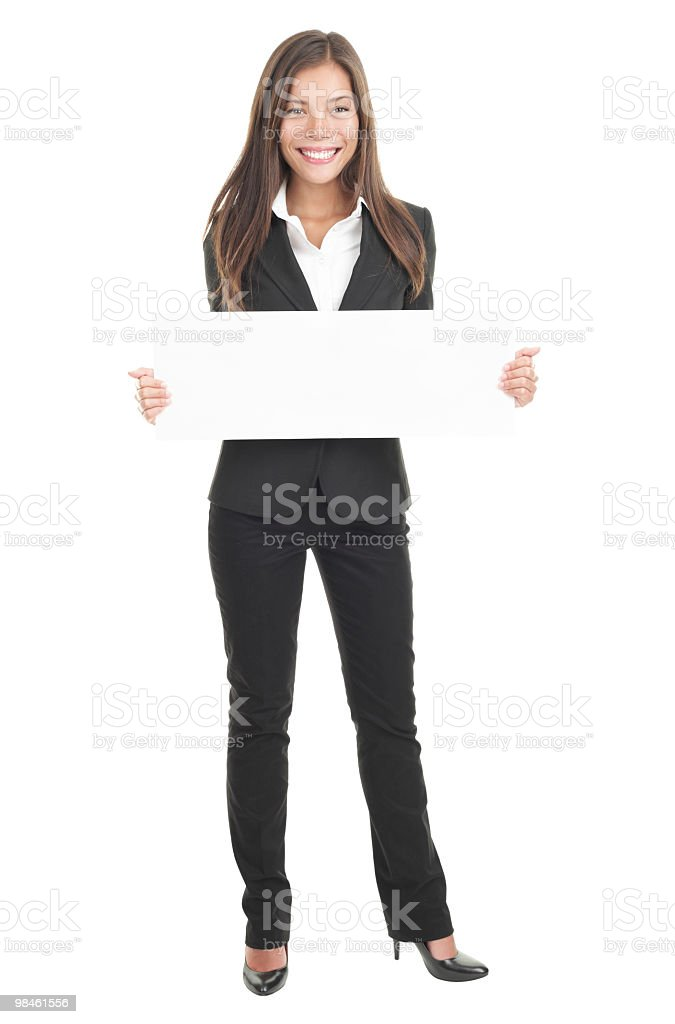 Businesswoman holding white blank sign royalty-free stock photo