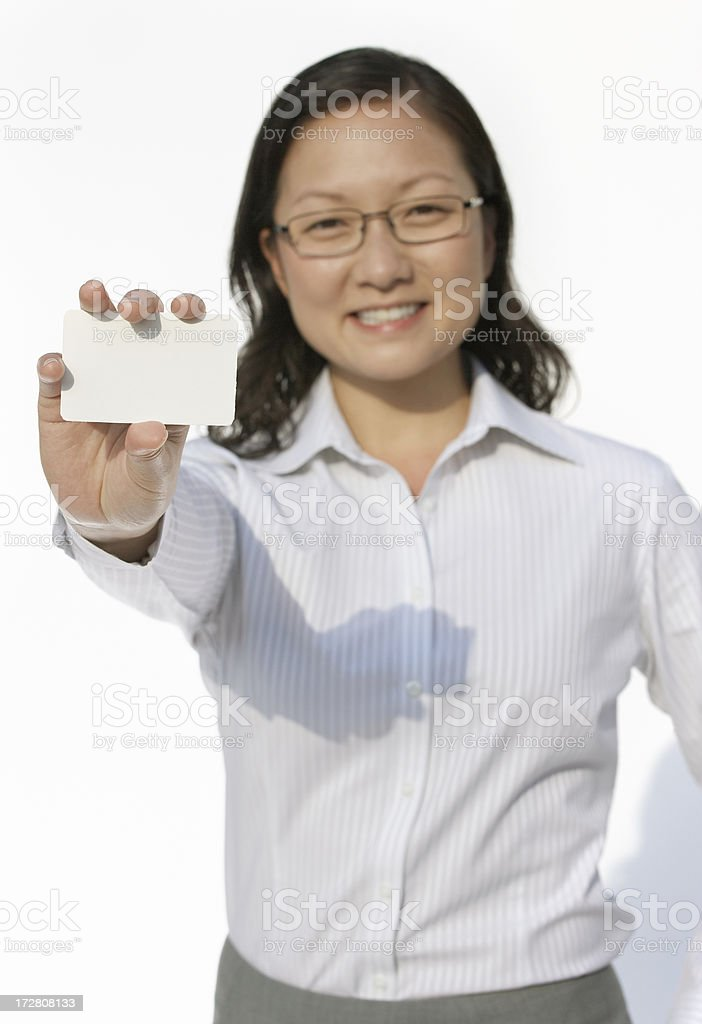 businesswoman holding white card royalty-free stock photo
