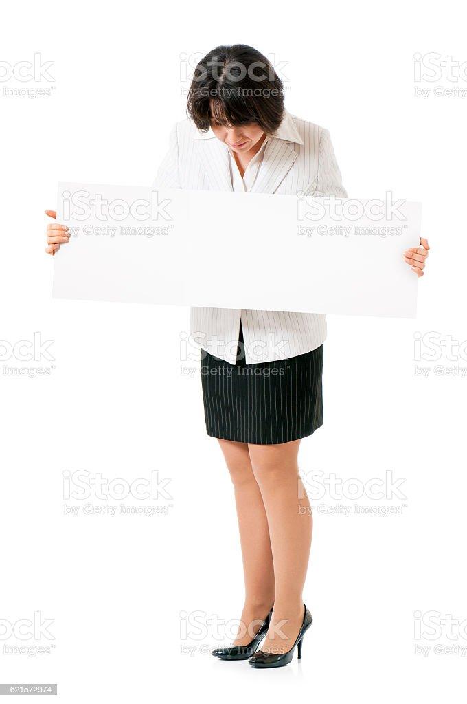 Businesswoman holding white poster photo libre de droits