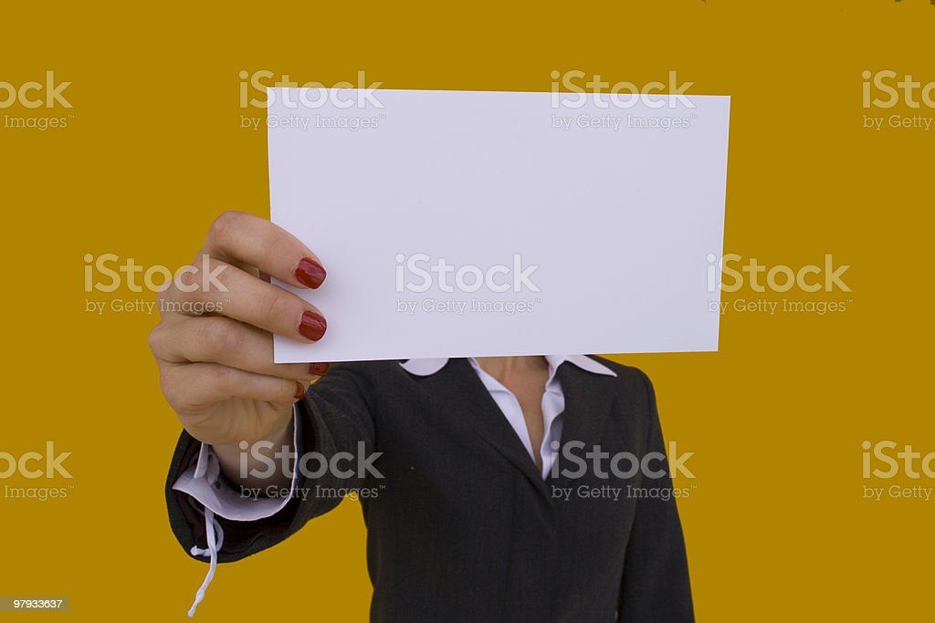 Businesswoman holds a blank card in front of her royalty-free stock photo