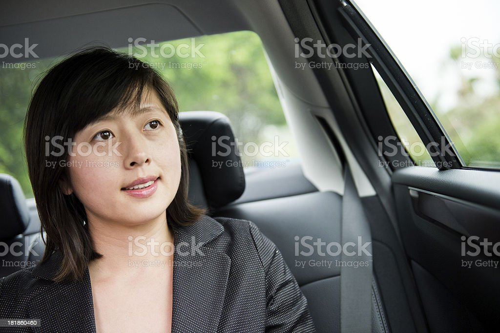 businesswoman in a car royalty-free stock photo