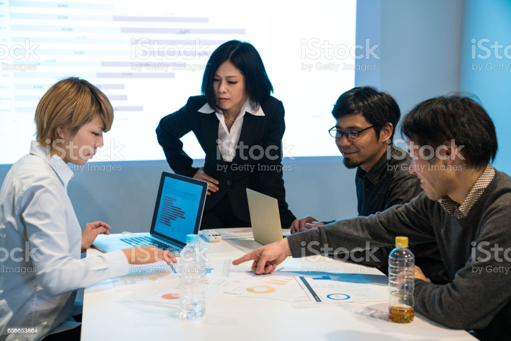 Businesswoman in a meeting in a board room with projection equipment stock photo