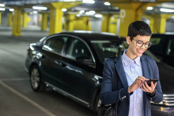 Businesswoman in a parking garage stock photo