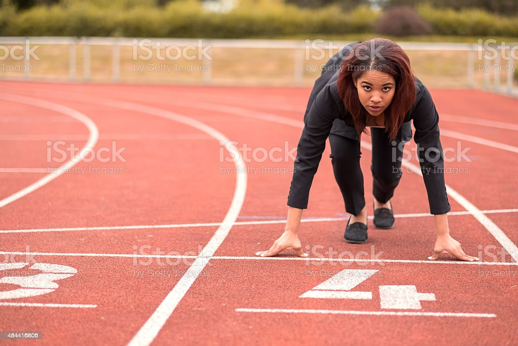 Businesswoman in a Start Position on Race Track stock photo