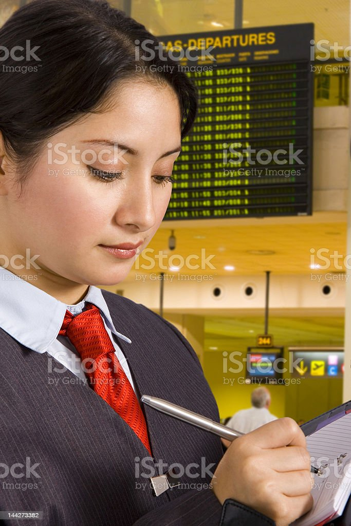 Businesswoman in airport royalty-free stock photo