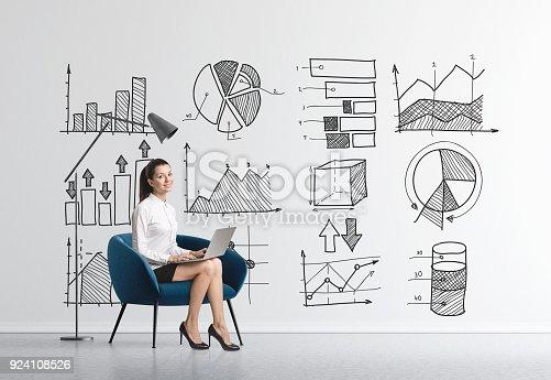 istock Businesswoman in armchair, infographics 924108526