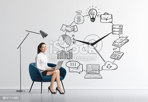 895493084 istock photo Businesswoman in armchair, time management 924111332