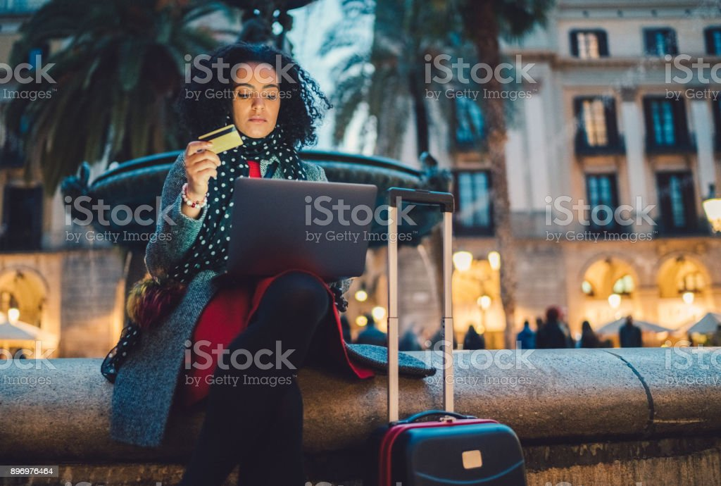 Businesswoman in Barcelona booking hotel online stock photo