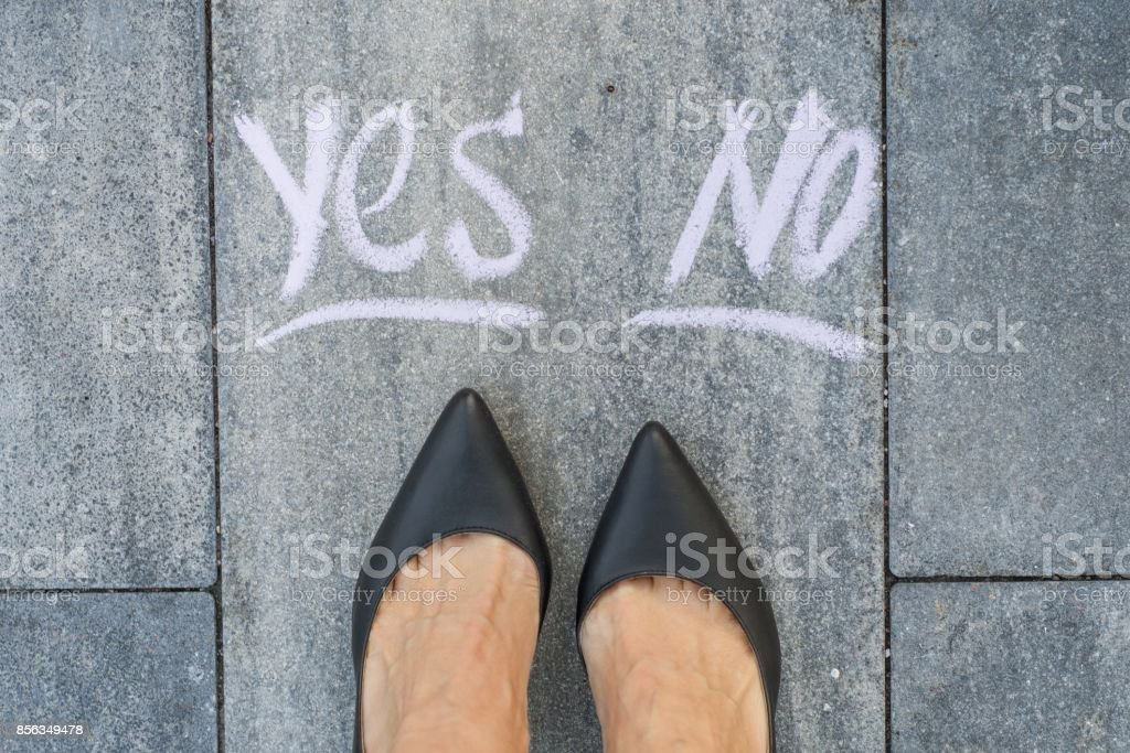 Businesswoman in black shoes, deciding where to go, yes or no stock photo