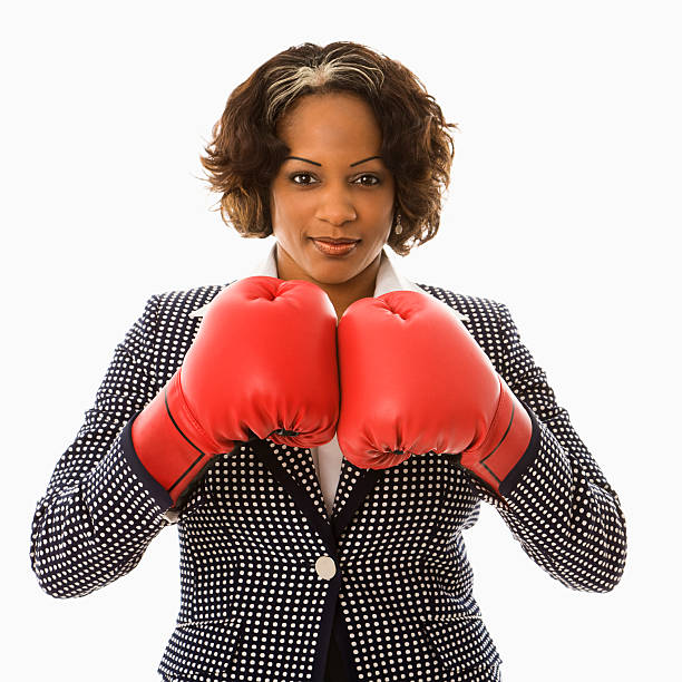 Businesswoman in boxing gloves. stock photo