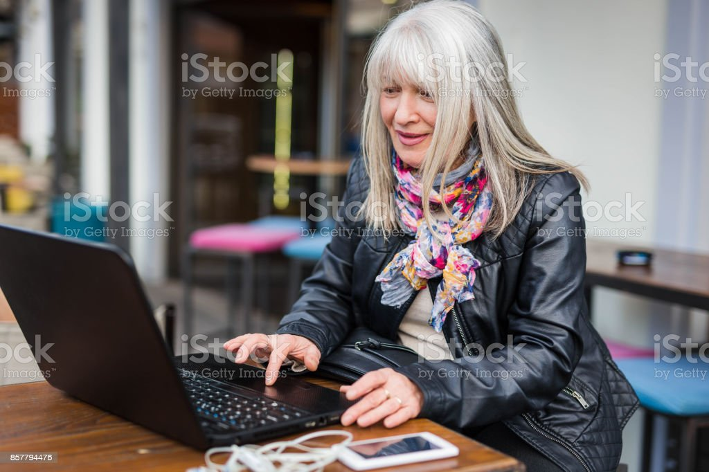 Businesswoman in cafe with laptop stock photo