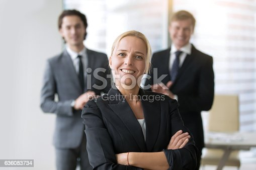 590048454 istock photo Businesswoman in center of group 636083734