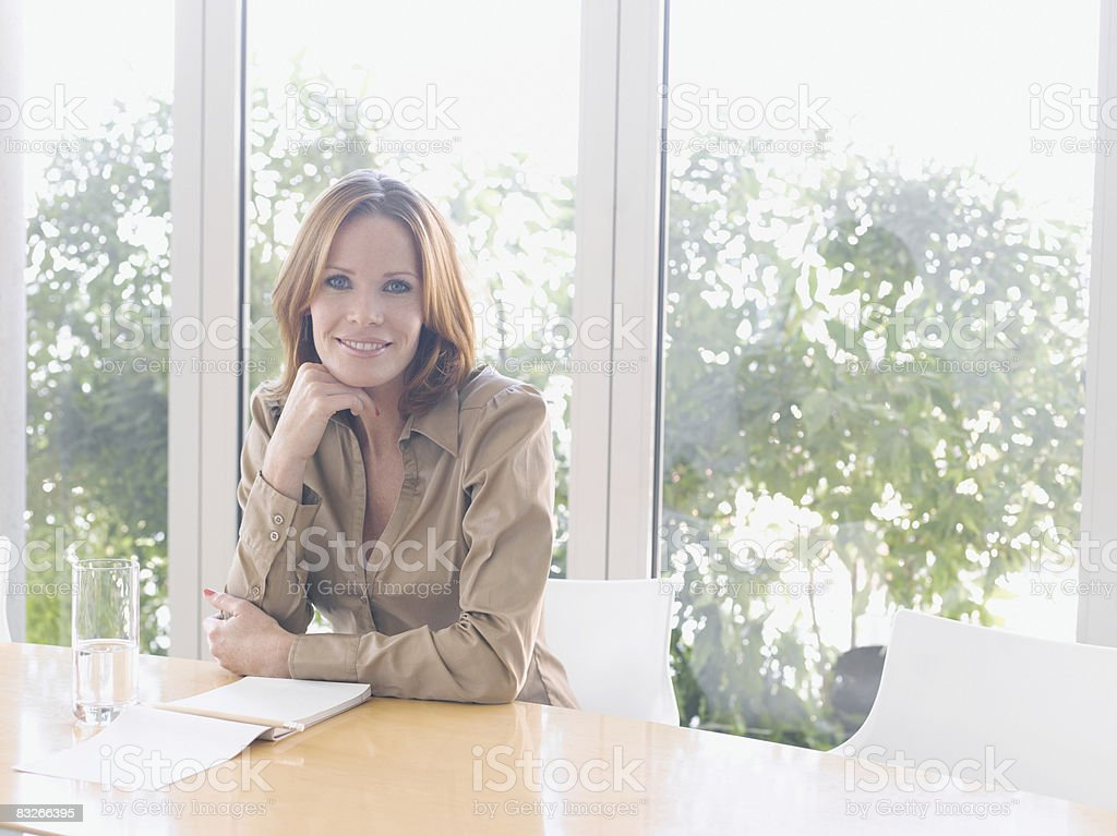 Businesswoman in conference room royaltyfri bildbanksbilder