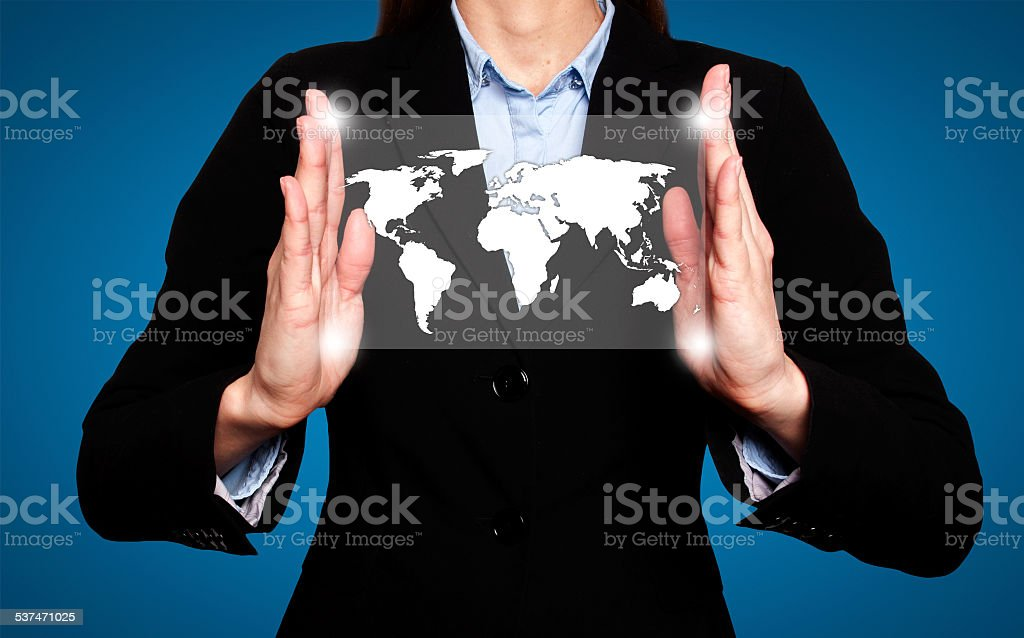 Businesswoman in dark suit holds world map global communication stock photo