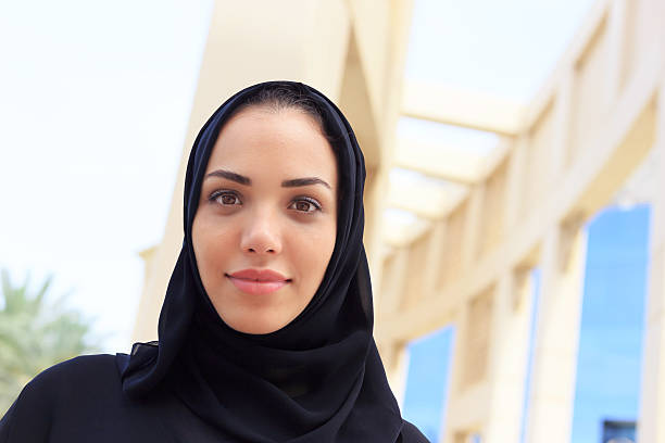 businesswoman in dubai - saudi woman stock photos and pictures