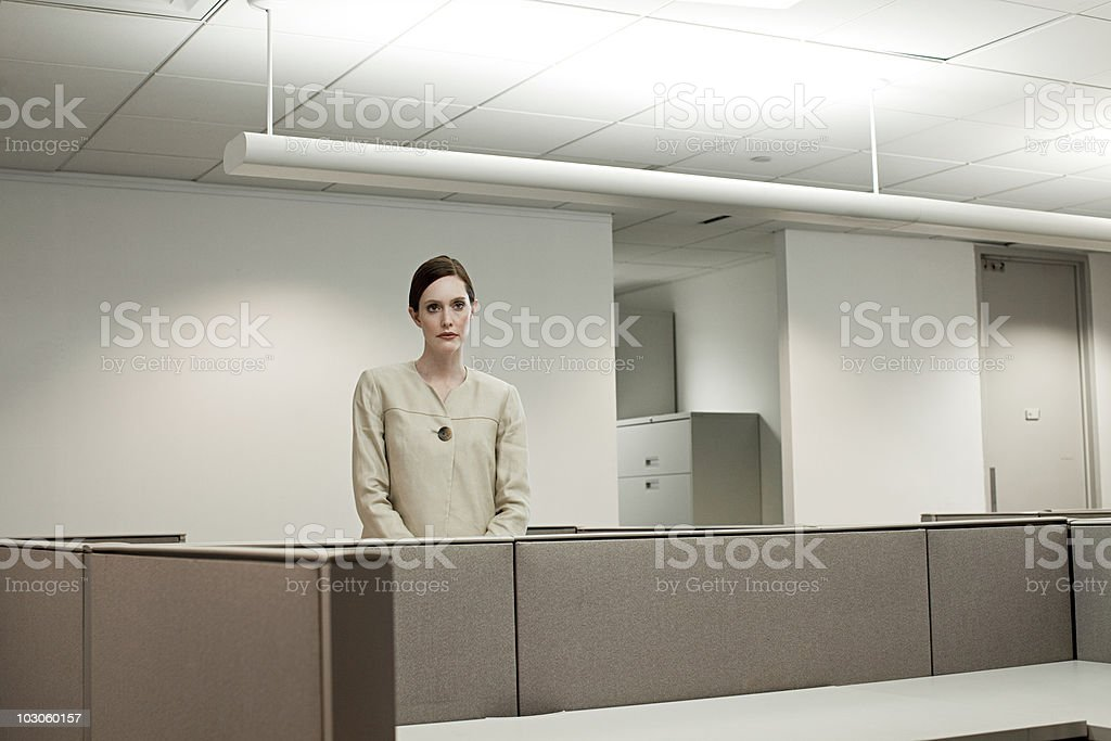 Businesswoman in empty office stock photo