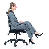 Businesswoman in grey suit on white background - sitting