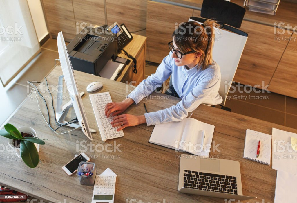 Businesswoman in her office. stock photo