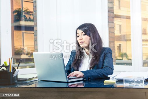 155279487 istock photo Businesswoman in her office working on laptop 172454160