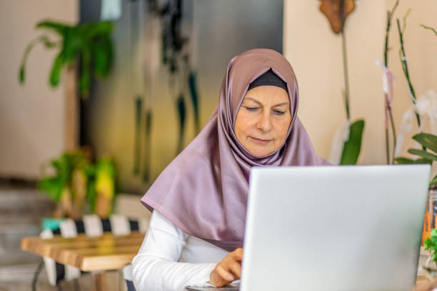businesswoman in hijab working with Laptop stock photo
