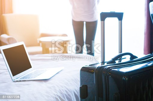 istock Businesswoman in hotel room 511327728