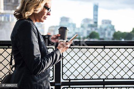 istock Businesswoman in London 914990312