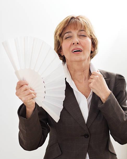 businesswoman in menopause - mature woman fever on white bildbanksfoton och bilder