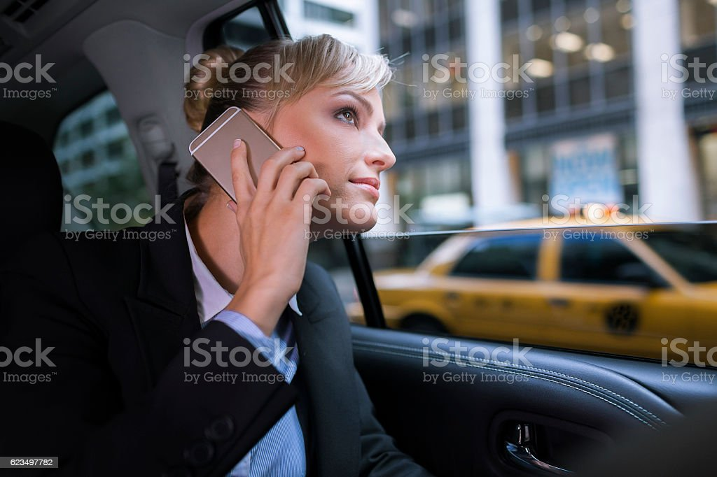 Businesswoman in NYC taxi stock photo