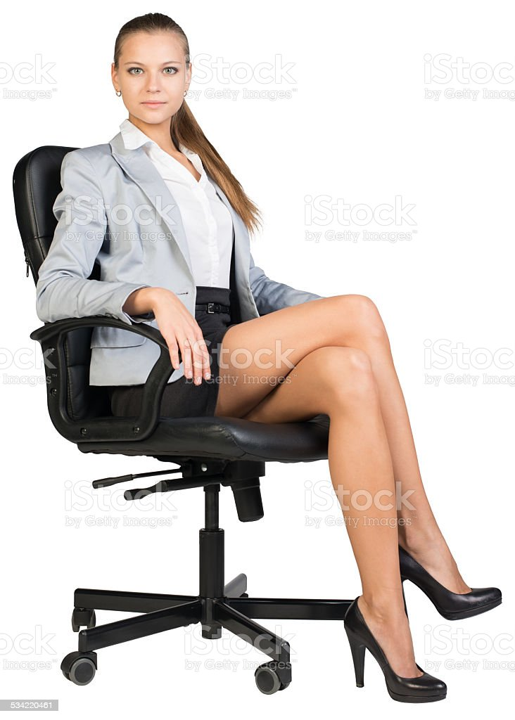 Businesswoman In Office Chair With Straight Back And