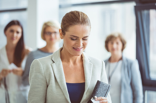 Businesswoman In Office Lobby Stock Photo - Download Image Now