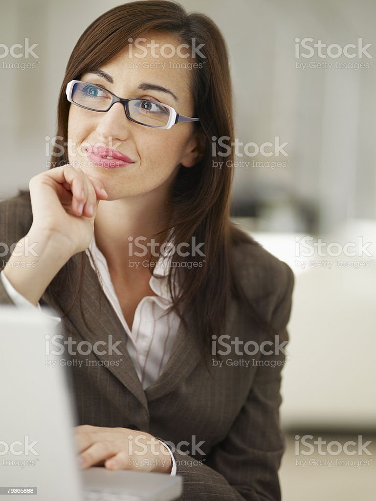 Businesswoman in office with laptop royalty-free stock photo