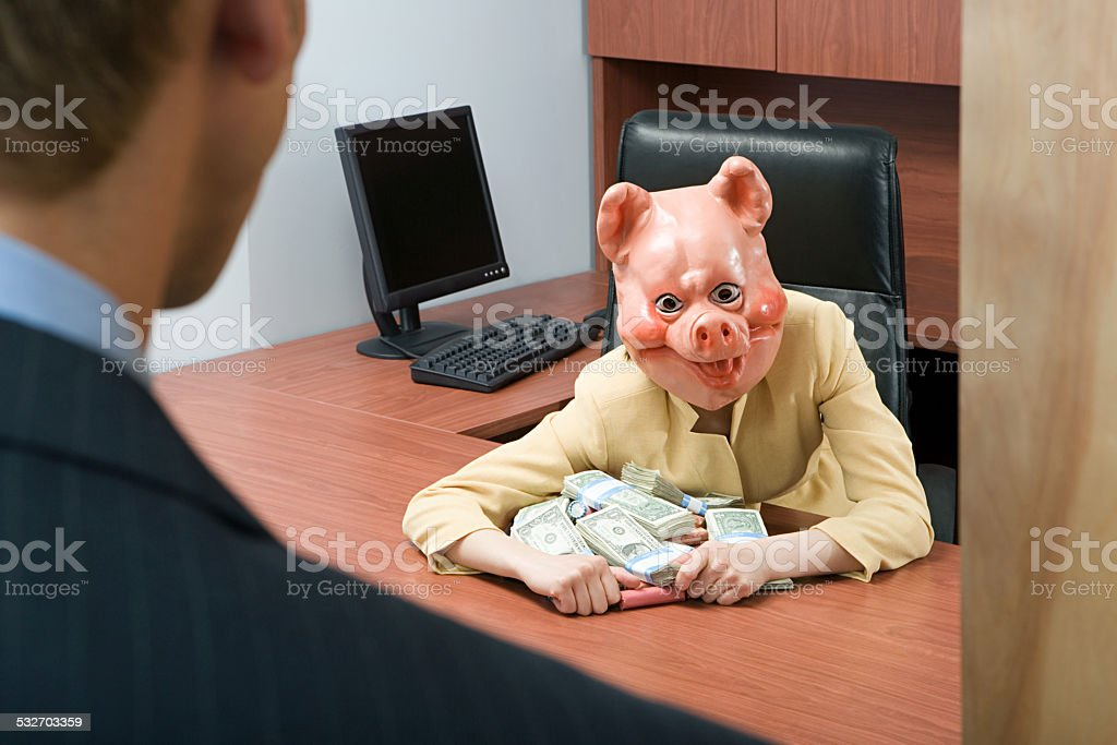 Businesswoman in pig mask holding money stock photo