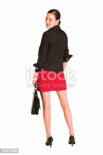istock Businesswoman in red miniskirt with leather case 91672855
