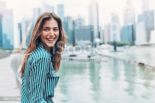 Portrait of a smiling young businesswoman outdoors in the city