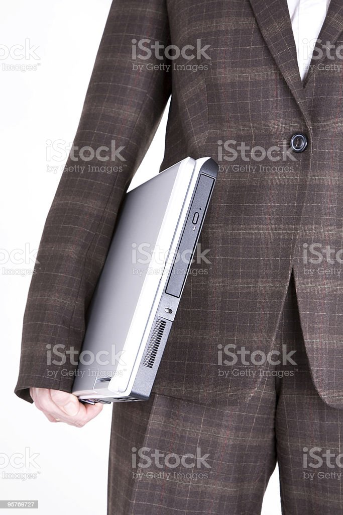 Businesswoman in suit holding laptop, low section, white background royalty-free stock photo