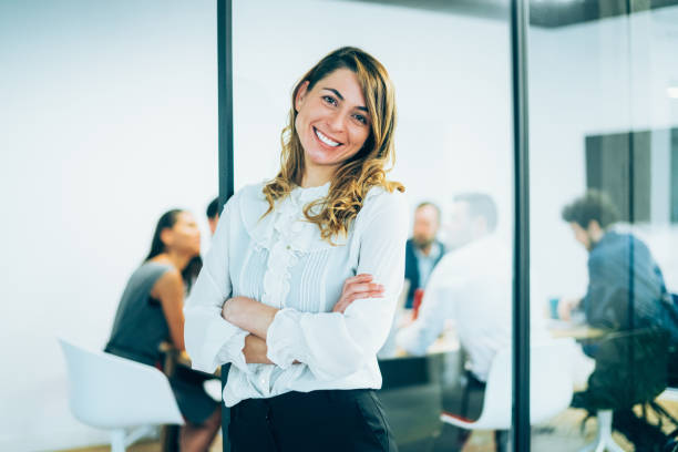 businesswoman in the office - violetastoimenova stock photos and pictures